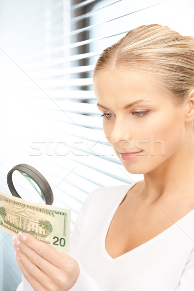 Stock photo: woman with magnifying glass and money
