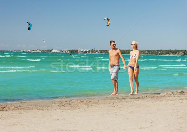 Stockfoto: Paar · lopen · strand · foto · gelukkig · vrouw