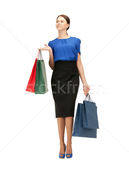 businesswoman with shopping bags on high heels Stock photo © dolgachov