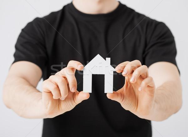 man hands holding paper house Stock photo © dolgachov