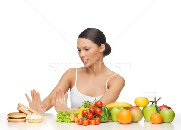 woman with fruits rejecting hamburger Stock photo © dolgachov