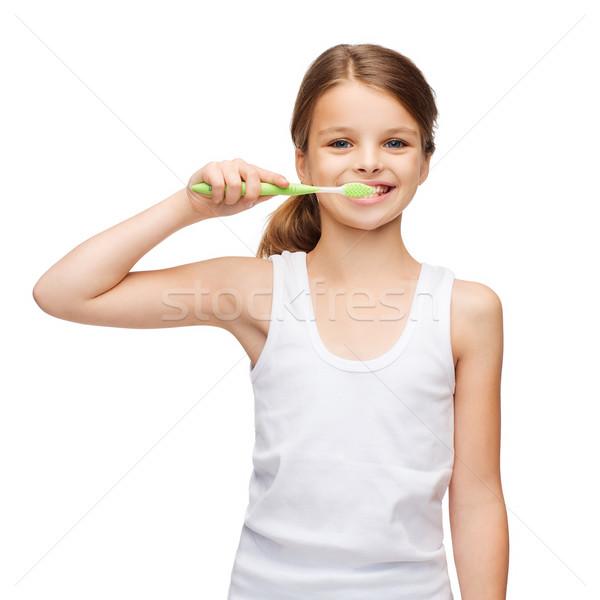 Lány fehér póló fogmosás terv egészség Stock fotó © dolgachov
