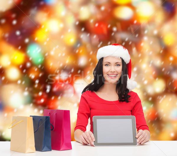 smiling woman in santa helper hat with tablet pc Stock photo © dolgachov