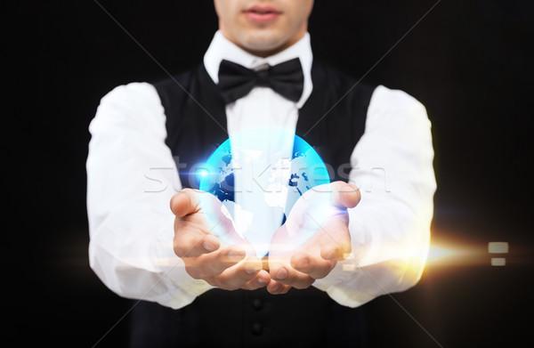 дилер мира ладонями рук магия Сток-фото © dolgachov