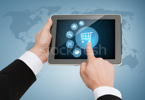 close up of man hands touching tablet pc Stock photo © dolgachov