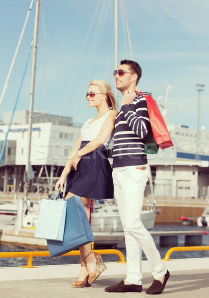 young couple in duty free shopping bags Stock photo © dolgachov