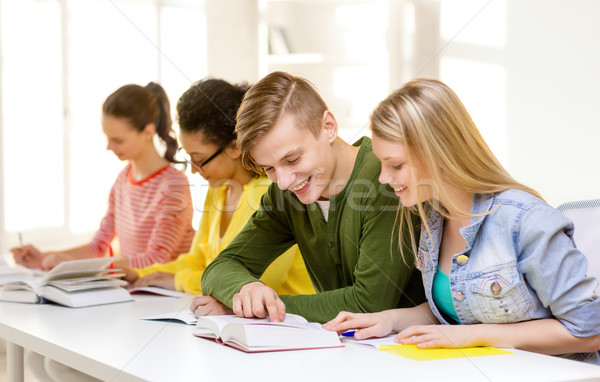 students with textbooks and books at school Stock photo © dolgachov