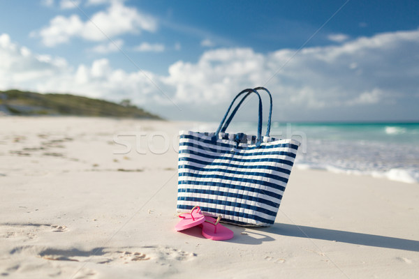 close up of beach bag and slippers at seaside Stock photo © dolgachov