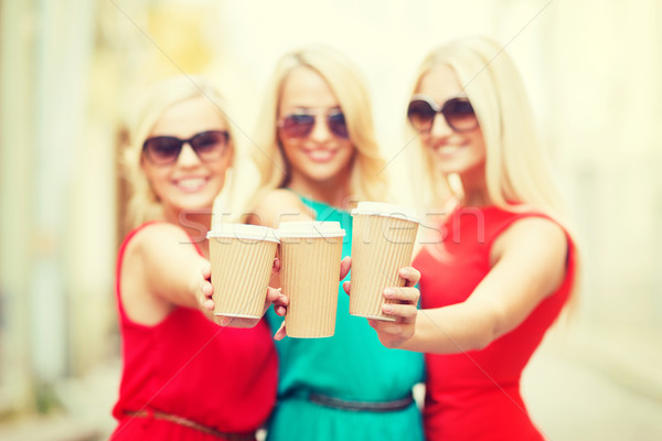 Stock photo: blonds holding takeaway coffee cups in the city