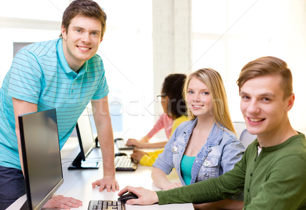 group of smiling students in computer class Stock photo © dolgachov
