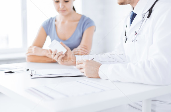 Stock photo: patient and doctor prescribing medication