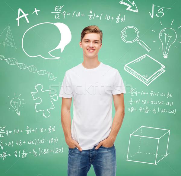 Souriant jeune homme blanche tshirt design éducation Photo stock © dolgachov