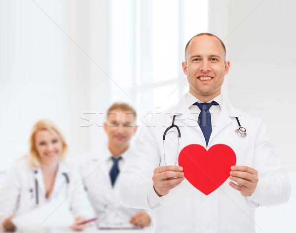 улыбаясь мужской доктор красный сердце стетоскоп медицина Сток-фото © dolgachov