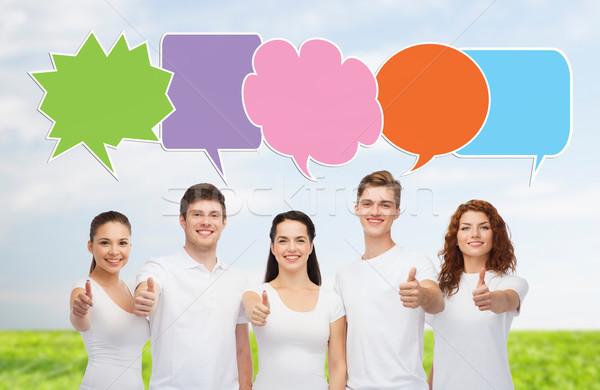 Groep glimlachend tieners tekst bubbels school Stockfoto © dolgachov