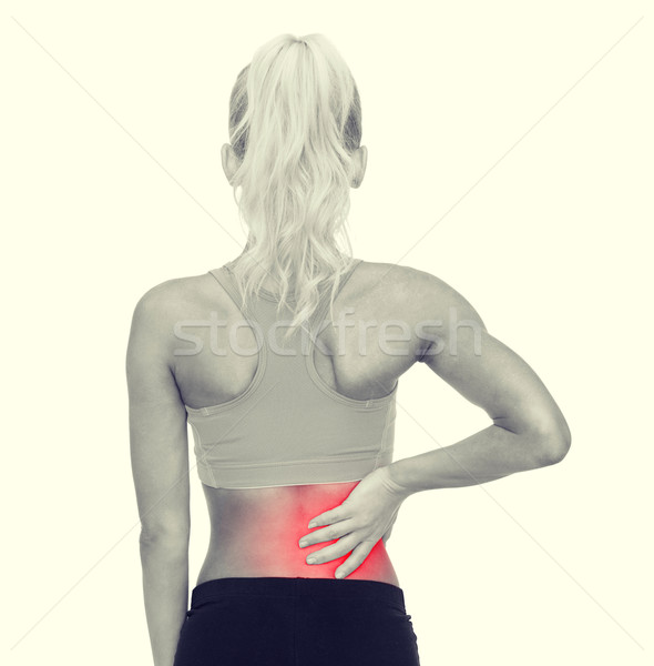 женщину прикасаться назад фитнес здравоохранения Сток-фото © dolgachov