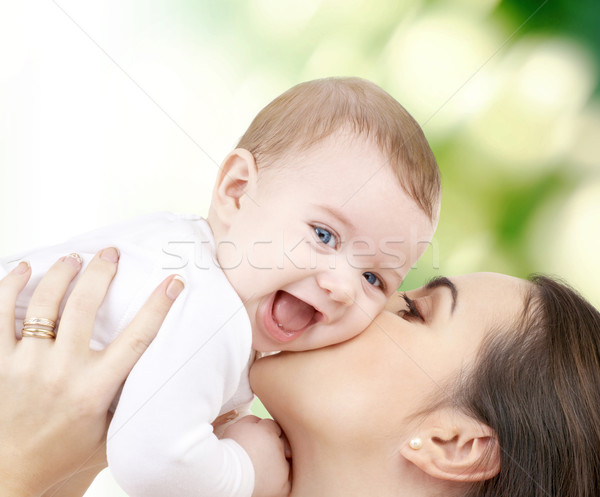 laughing baby playing with mother Stock photo © dolgachov