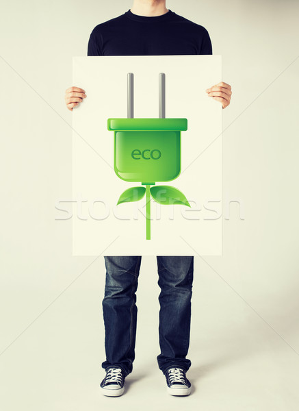 hands holding picture of green electrica ecol plug Stock photo © dolgachov