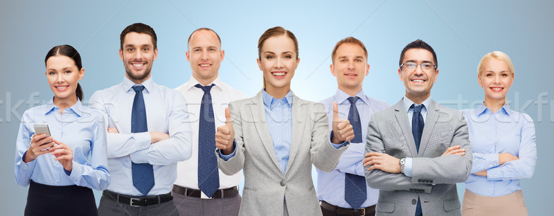 group of happy businesspeople showing thumbs up Stock photo © dolgachov
