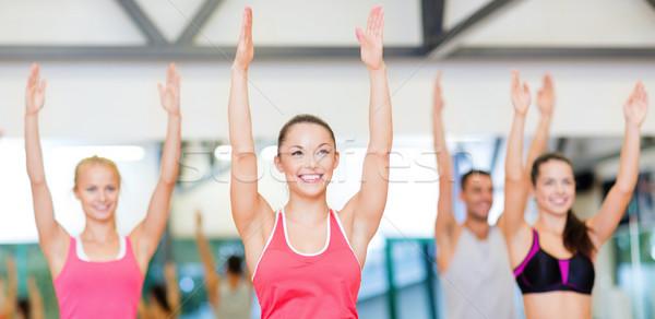 Stok fotoğraf: Grup · gülen · insanlar · egzersiz · spor · salonu · uygunluk