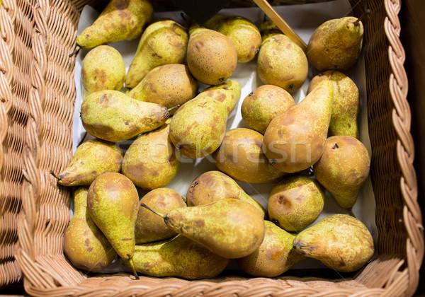 ripe pears in basket at food market or farm Stock photo © dolgachov