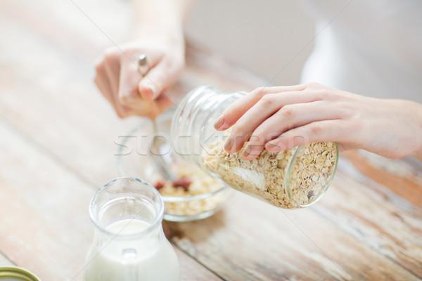 Közelkép nő eszik müzli reggeli étel Stock fotó © dolgachov