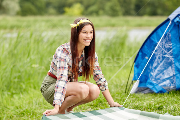 happy young woman laying blanket at campsite Stock photo © dolgachov