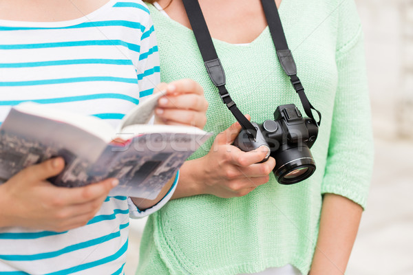 close up of women with city guide and camera Stock photo © dolgachov