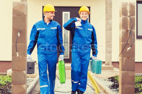 Grupy budowniczych działalności budynku zespołowej ludzi Zdjęcia stock © dolgachov