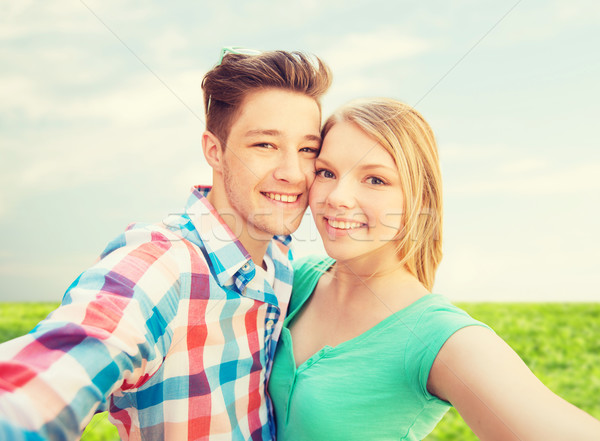 smiling couple with smartphone in suburbs Stock photo © dolgachov