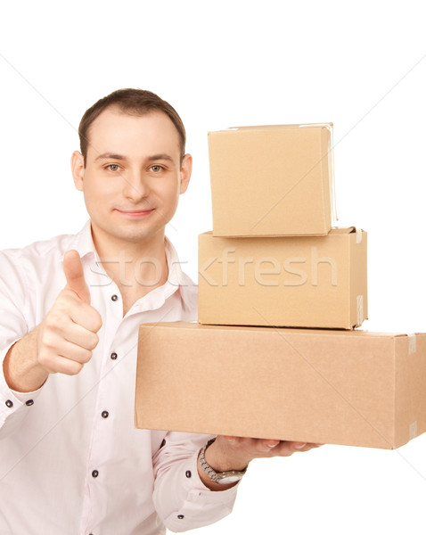 businessman with parcels Stock photo © dolgachov