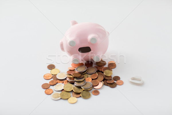 close up of euro coins and piggy bank on table Stock photo © dolgachov