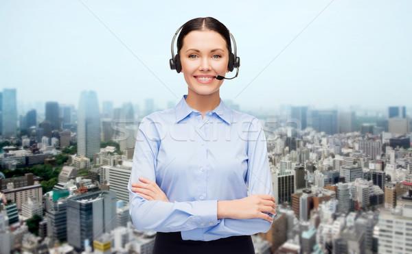 Segélyvonal kezelő headset város üzletemberek technológia Stock fotó © dolgachov