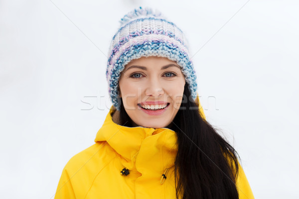 happy young woman in winter clothes outdoors Stock photo © dolgachov