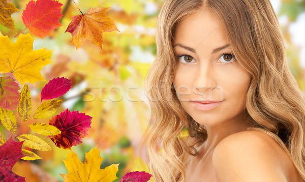beautiful young woman face over autumn leaves Stock photo © dolgachov