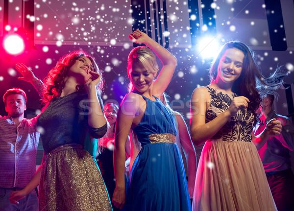 smiling friends dancing in club Stock photo © dolgachov