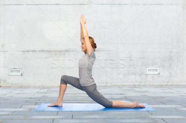 счастливым женщину йога низкий фитнес Сток-фото © dolgachov