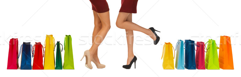 close up of women on high heels with shopping bags Stock photo © dolgachov