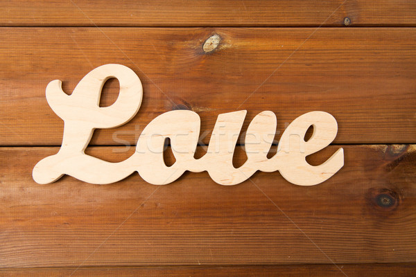 Stock photo: close up of word love cutout on wood