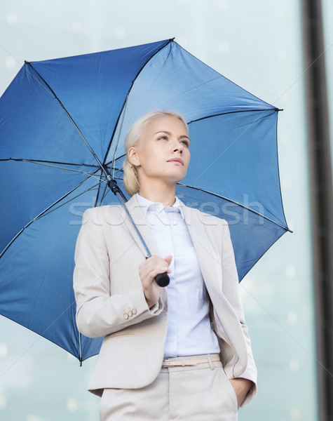 Jonge ernstig zakenvrouw paraplu buitenshuis business Stockfoto © dolgachov