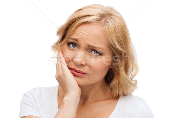 unhappy woman suffering toothache Stock photo © dolgachov