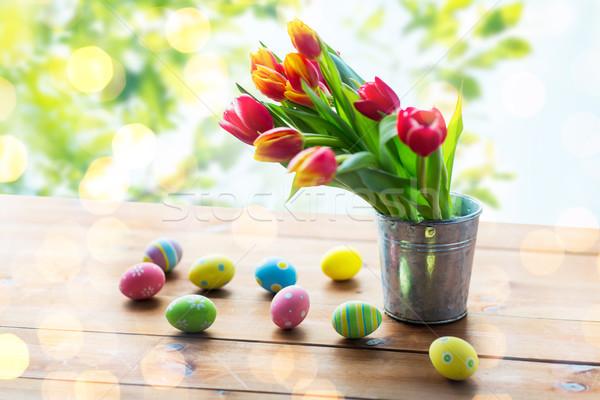œufs de Pâques fleurs étain seau Pâques Photo stock © dolgachov