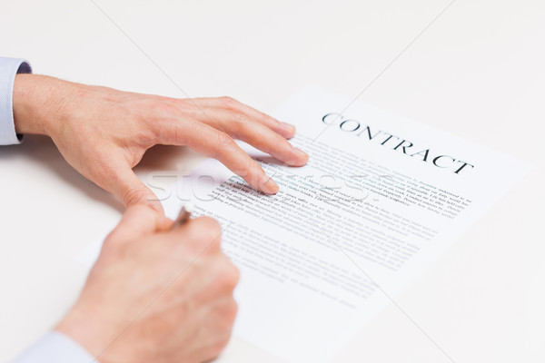 close up of male hands signing contract document Stock photo © dolgachov