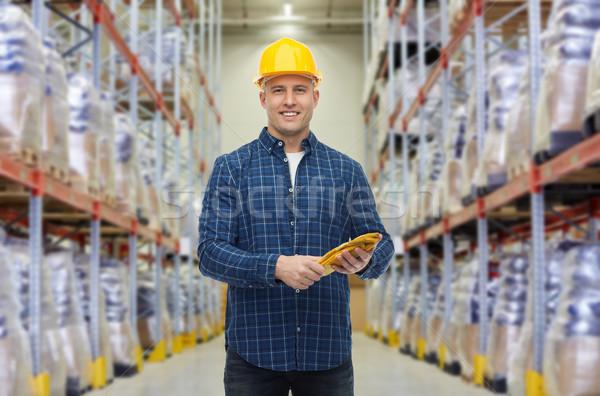 Boldog férfi munkavédelmi sisak kesztyű raktár raktár Stock fotó © dolgachov