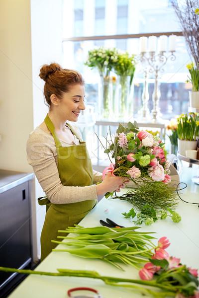 Sorridere fiorista donna Foto d'archivio © dolgachov