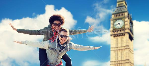 Feliz adolescente casal Big Ben torre Foto stock © dolgachov