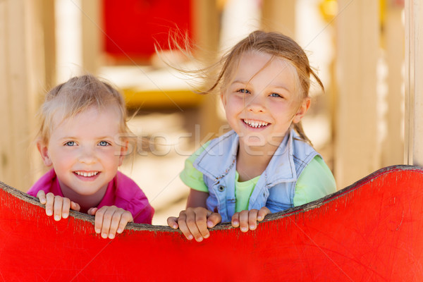 happy kids on children playground Stock photo © dolgachov