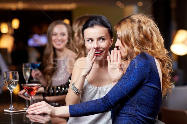 happy women with drinks at night club Stock photo © dolgachov