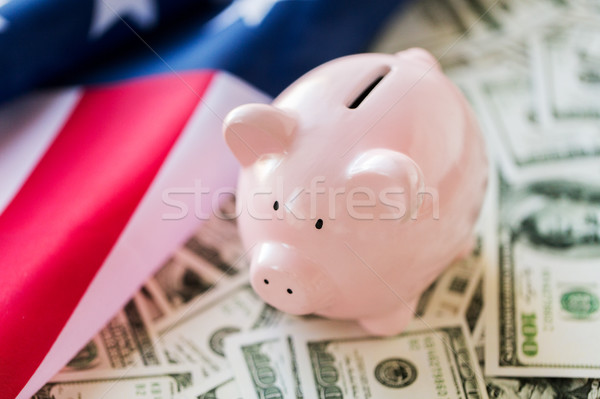 close up of american flag, piggy bank and money Stock photo © dolgachov