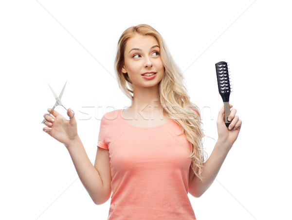 young woman with scissors and hairbrush Stock photo © dolgachov