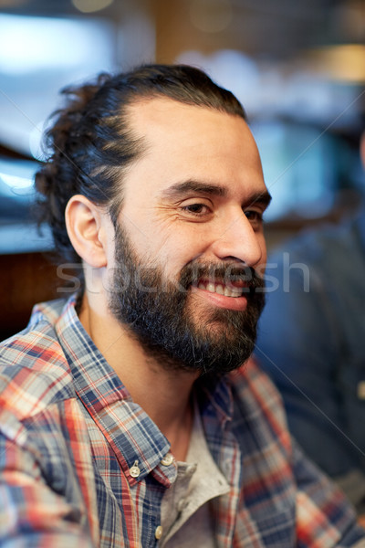 happy smiling middle eastern man face with beard Stock photo © dolgachov
